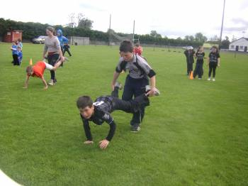 Students competing in the wheelbarrow race